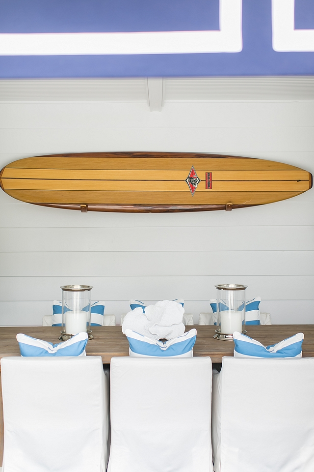 Outdoor dining area decorated with a surfboard Surfboard is from Bird Surfboards #surfboard #bidsurboards