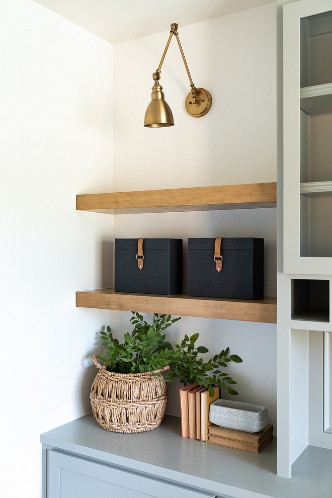 Brass Swing Arm Sconce over White Oak Floating Shelves Custom cabinet with Brass Swing Arm Sconce over White Oak Floating Shelves #BrassSwingArmSconce #SwingArmSconce