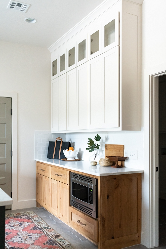 Kitchen Buffet Cabinet This two-toned kitchen buffet features custom-stained Maple lower cabinets and custom white upper cabinets with shaker doors #KitchenBuffetCabinet #Kitchen #BuffetCabinet #twotonedkitchen #shakerdoors
