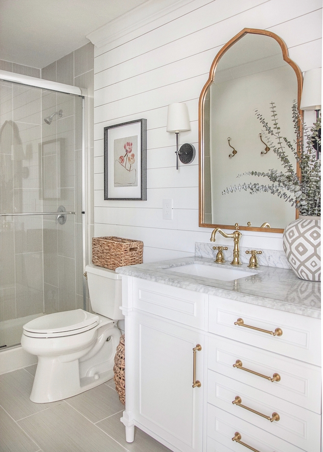 Shiplap Bathroom Reno I painted everything white and brought in more dimension with the shiplap wall, and changed out the overhead vanity light for three sconces surrounding the arched brass mirrors Shiplap Bathroom Reno Shiplap Bathroom Reno #Shiplap #BathroomReno #shiplapBathroomReno