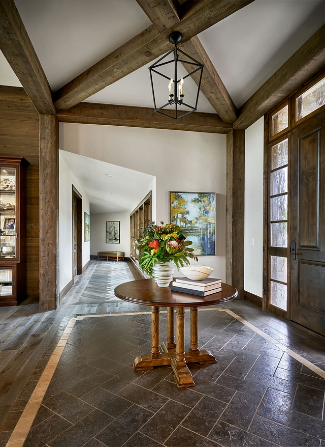 Entryway Foyer Beams The entry has beams that come together to provide some interest and also set the tone for the rustic feel of the home #entryway #foyer #Beams #rustic #rusticinteriors #rusticdesign