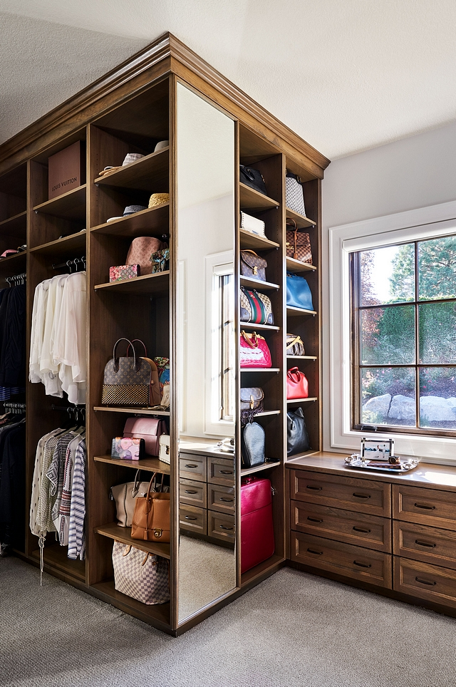 Closet cabinetry is Weathered Oak, recessed flat panel with decorative mold #closet #cabinetry
