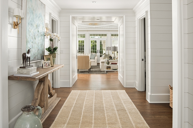 Benjamin Moore OC-65 Chantilly Lace Benjamin Moore OC-65 Chantilly Lace shiplap The front door opens to a beautiful foyer with shiplap walls painted in Benjamin Moore OC-65 Chantilly Lace #shiplap #BenjaminMooreOC65ChantillyLace
