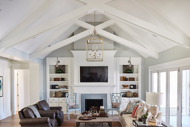 "Crossed trusses Vaulted ceiling with Crossed trusses Custom-designed crossed trusses gives continuity to the ""X"" theme found in many spaces of this home, including cabinetry and furniture Crossed trusses #Crossedtrusses #vaultedceiling #trusses"