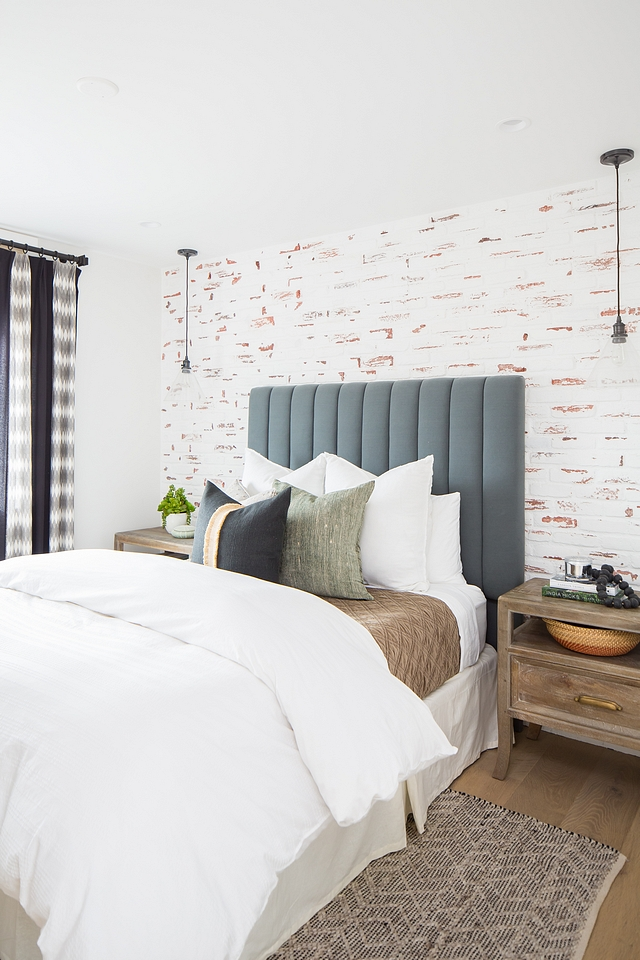 DIY Distressed painted brick DIY Distressed painted brick accent wall Featuring a distressed painted brick accent wall, this bedroom would be a dream for anyone who loves the farmhouse trend #DIYDistressedpaintedbrick #distressedbrick #paintedbrick #farmhouse #farmhousetrend