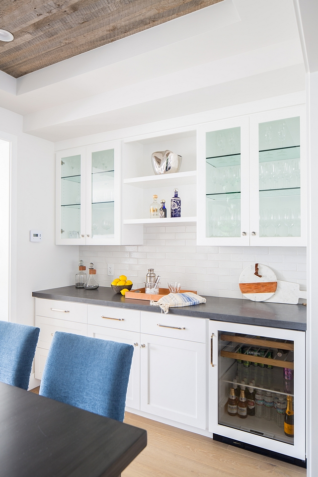A butler's pantry is located on the other side of the dining room, just across from the table Dining Room Bar Cabinet Paint Color Dunn Edwards White DEW380 Dining Room Bar Cabinet #butlerpantry #DiningRoom #Bar #BarCabinet