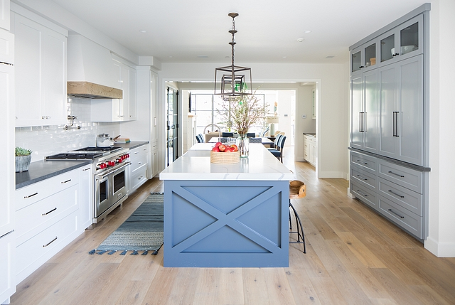 White paint color for kitchen cabinets The white selected for the cabinets is the builder's signature white; Dunn Edwards - White - DEW380. It is their go-to white for walls and trim too #gotowhitepaintcolor #whitepaintcolor #whitecabinetpaintcolor #whitekitchenpaintcolor