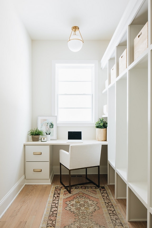 Mudroom The mudroom convinently features a custom built-in desk and plenty of cubbies Mudroom ideas Mudroom layout Mudroom Runner Mudroom Lighting Mudroom Cubbies Mudroom Desk #Mudroom #cubbies #Mudroomideas #Mudroomlayout #MudroomRunner #MudroomLighting #MudroomCubbies #MudroomDesk