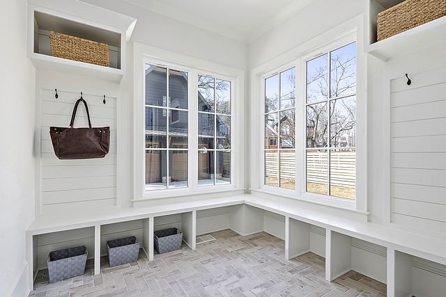 Mudroom shiplap and herringbone brick tile Durable brick tile ensures that you don't ruin your floors and allows for easy cleanup of messes #Mudroom #shiplap #herringbonebricktile