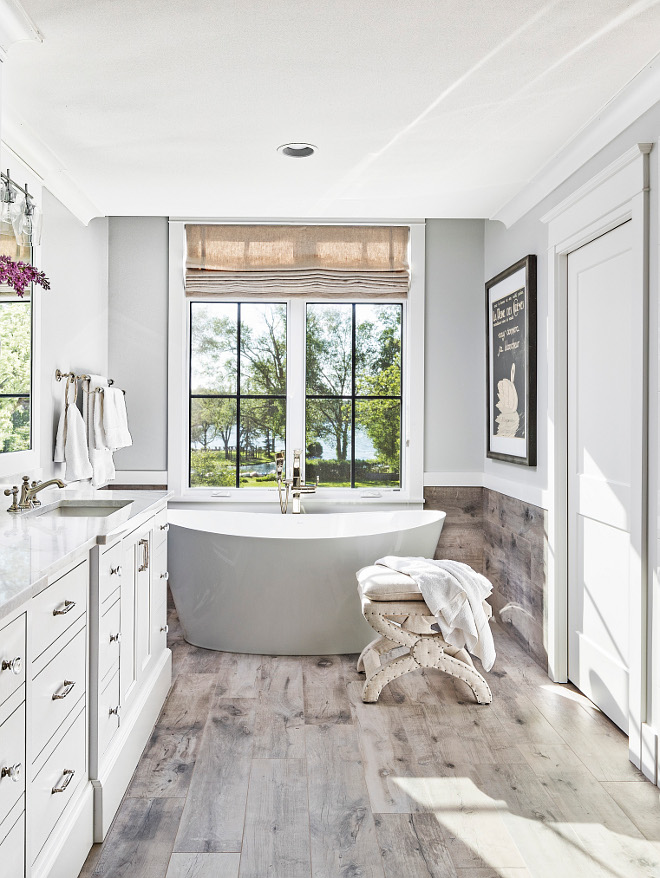Master bathroom flooring We used a ceramic tile that resembles wood planks on the floor and brought it 3 feet as a wainscoting up the wall to give a more intimate feel #Masterbathroom #flooring #tile #woodtile #woodtiling #bathroomwainscoting