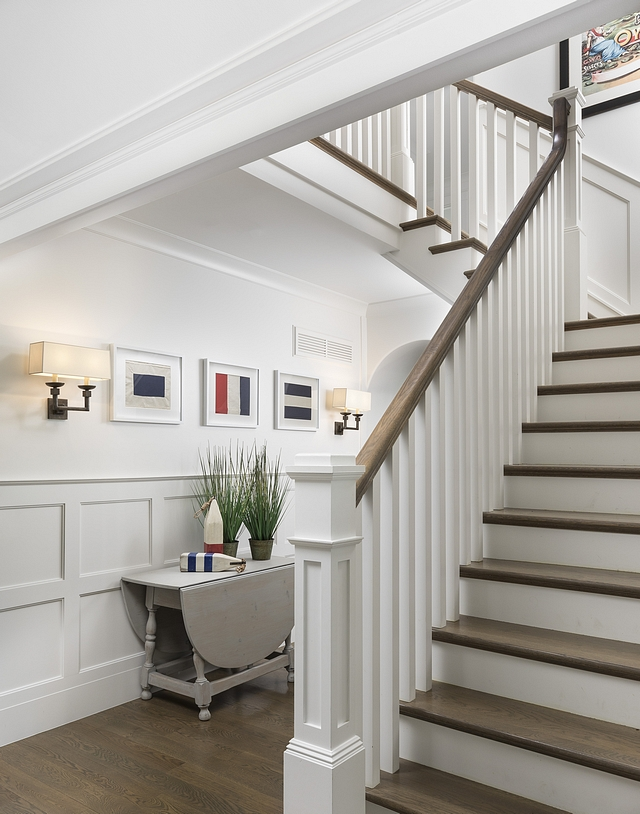 Traditional Staircase The spindles on the stairs have a simple classic Arts and Crafts line. We painted the spindles and newel posts and contrasted the handrail and staircase treads to match the wood stain on the plank flooring #traditionalstaircase #staircase
