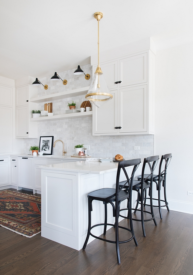 Townhouse Kitchen Design Because this townhouse has another unit attached, the kitchen of this home does not have a window in the prep area. We used floating shelves over the kitchen sink to create an open and airy feeling where one usually has a window. If we would have carried the cabinets all around the boxy shaped room it would have felt very closed up and boring. The shelves add so much interest and depth to the kitchen #townhousekitchen #townhouse #kitchen
