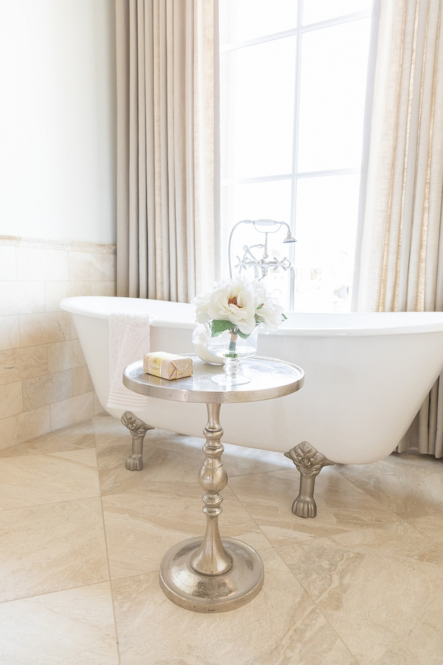 A cast iron clawfoot tub brings a traditional French feel to this bathroom