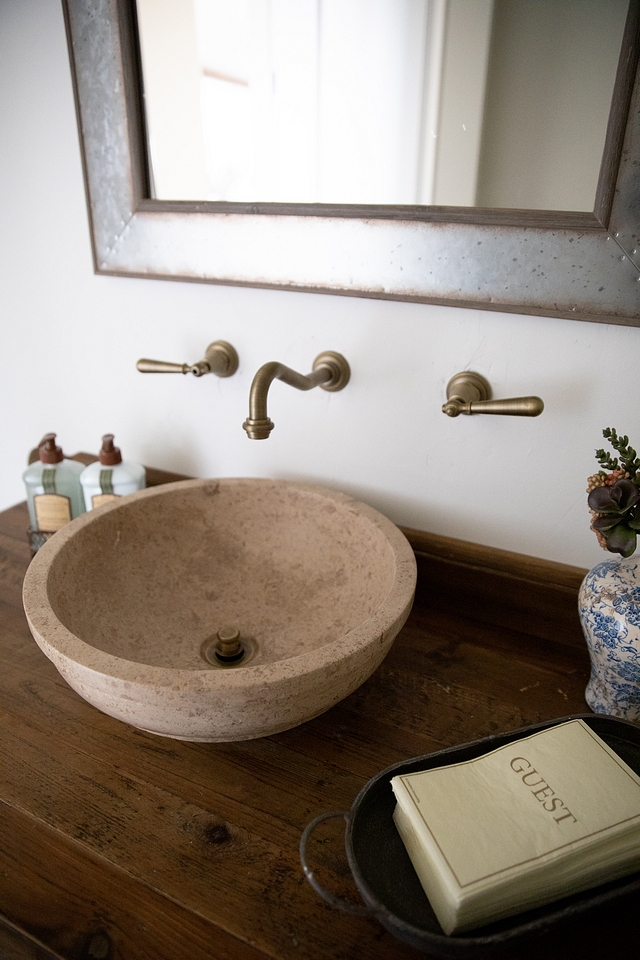 Antique Brushed brass wall mounted faucet and stone vessel sink #bathroom