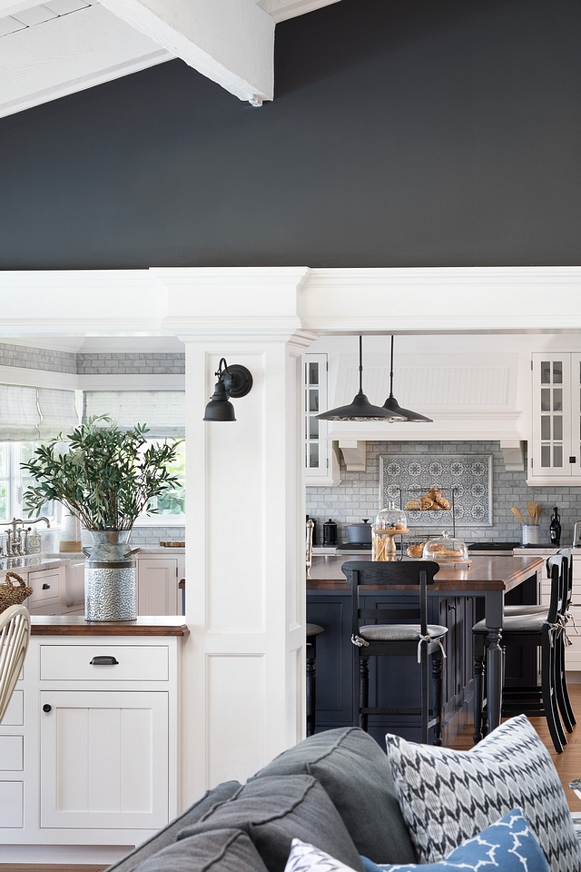 Wrought Iron by Benjamin Moore with Benjamin Moore White Dove Trim The trim and built-ins are painted in a soft white paint color, Benjamin Moore White Dove OC-17, which beautifully contrasts with the dark walls, in Benjamin Moore Wrought Iron #WroughtIronBenjaminMoore #BenjaminMooreWhiteDove