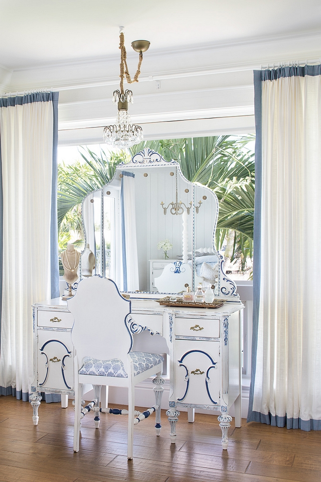 The make-up vanity and chair are antiques, refinished in Benjamin Moore White Dove and hand-painted blue accents