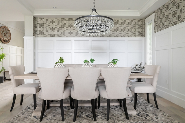 Dining Room with wallpaper above wainscoting Dining room with Classic wainscoting and a neutral geometric wallpaper above Dining Room with wallpaper above wainscoting #DiningRoom #wallpaperabovewainscoting #diningroomwainscoting #wainscoting