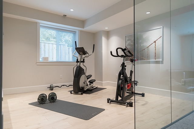 """Home Gym The first question people ask when they see this room is, """"do you actually use your gym?"""" Why yes, yes we do! We added 3 large glass panels, so this room doesn't feel closed off from the rest of the basement #homegym"""