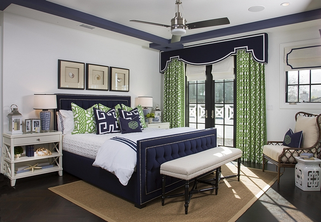 Featuring a navy blue and Kelly green color scheme, this master bedroom exudes a timeless and far-from-boring approach #bedroom #masterbedroom #colorscheme #bedroomcolorscheme