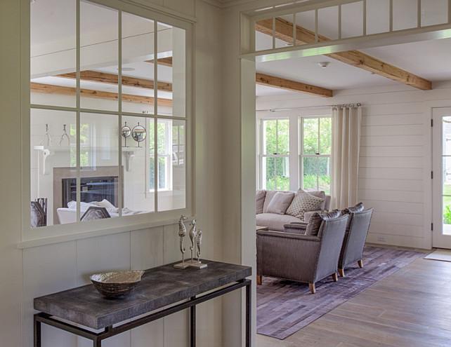 Foyer. Foyer with plank walls, wide plank hardwood flooring, transoms and interior window to expand natural light. #Fioyer #plankWalls #PlankFloors #InteriorWindows Jonathan Raith Inc.