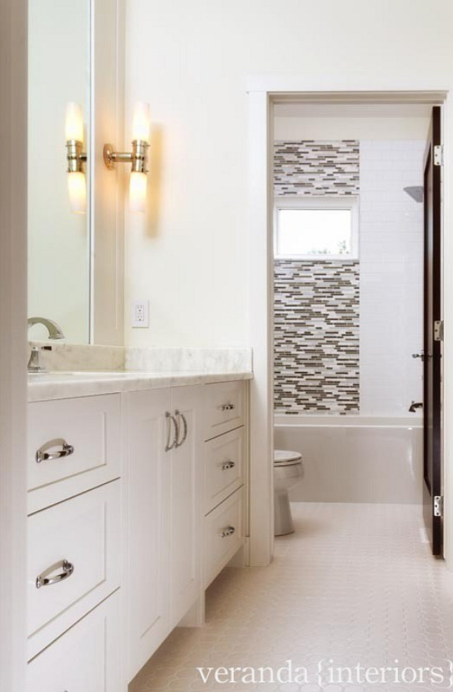 Traditional Bathroom Idea In Nashville With Recessed Panel Cabinets White Beige Tile