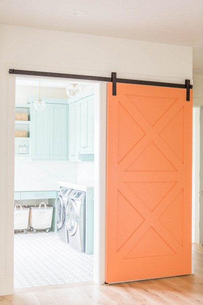 Barn Door Decor Orange Painted Door Laundry Room Washer and Dryer House Home Decor Interior Design Space Saver