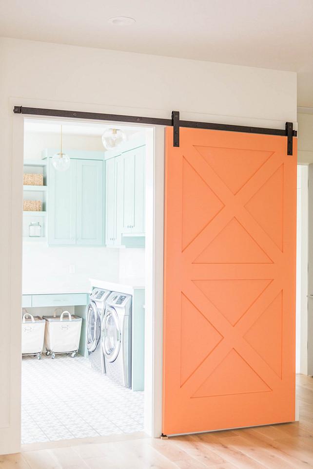 barn door decor orange painted door laundry room washer and dryer house home decor interior design