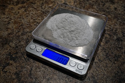 a pile of dextrose priming sugar being weighed on a digital scale