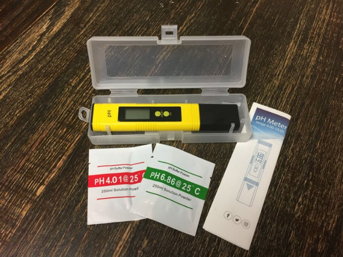 yellow digital ph meter and testing packets