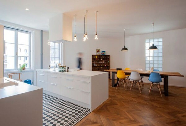 Checkerboard tiles in the kitchen area are a nice touch in this contemporary open-plan space.