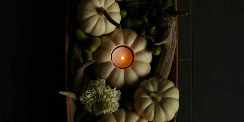 This white pumpkin centerpiece is an easy fall decor DIY. The mini pumpkin tea lights are quick to make and will light up your autumn table! | Home for the Harvest #minipumpkins #pumpkins #pumpkincenterpiece #pumpkin #falldecor #autumndecor #homefortheharvest
