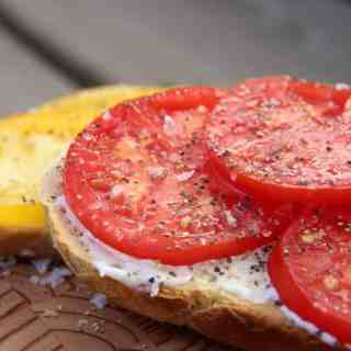 Tomatoes on toast are SO yummy if you've got fresh heirloom tomatoes! Tomato toast is my all-time favourite summer snack. It's the perfect garden-to-table meal during harvest season!   Home for the Harvest #heirloomtomatoes #heirloomtomato #tomatotoast #tomatoesontoast #gardentotable #homefortheharvest