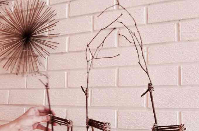 I LOVE twig reindeer at Christmas! They're such a cute Christmas craft for a girls' night. They look so great on the Christmas mantle too. Here's how to make your own twig reindeer! #twigreindeer #stickreindeer #DIYreindeer #reindeermantle