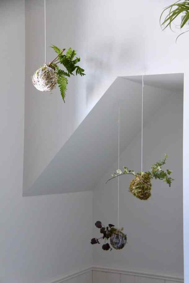These hanging plants are so fun! This kokedama moss ball is an easy way to bring greenery into your home year-round. #kokedama #mossball #kokedamamossball #stringgarden #moss