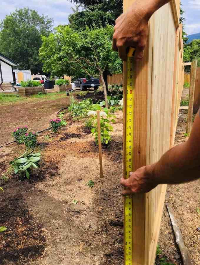 diy privacy fence installation of backyard cedar fencing