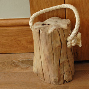 Wooden tree stump doorstop