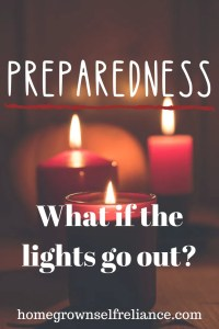 Red candles with flame - Preparedness - What if the lights go out?