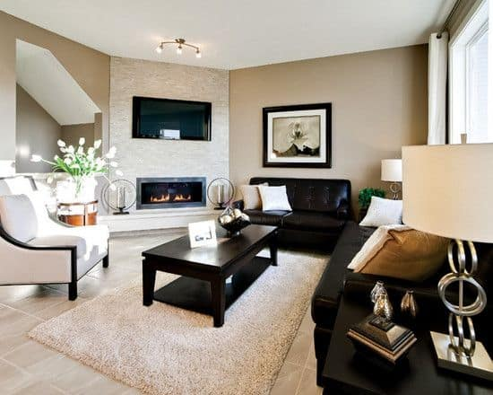 Effective living room layouts for your fireplace and tv for Family room furniture layout tv fireplace