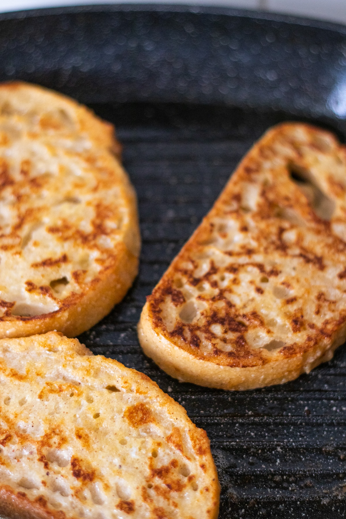 Close up of sourdough french toast in frying pan