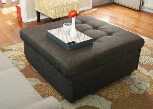Take an ugly coffee table and transform it into a DIY ottoman! Save SO much on making a custom piece of furniture!!