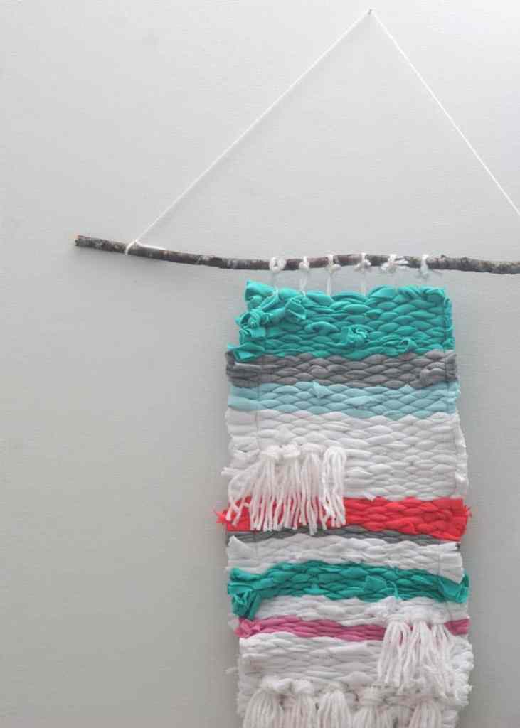 Learn how to make a woven wall hanging out of t-shirts. This DIY woven wall hanging craft is easy for kids to make!