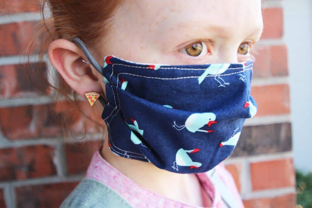 Learn how to make a face mask for kids using ponytail holders instead of elastic!
