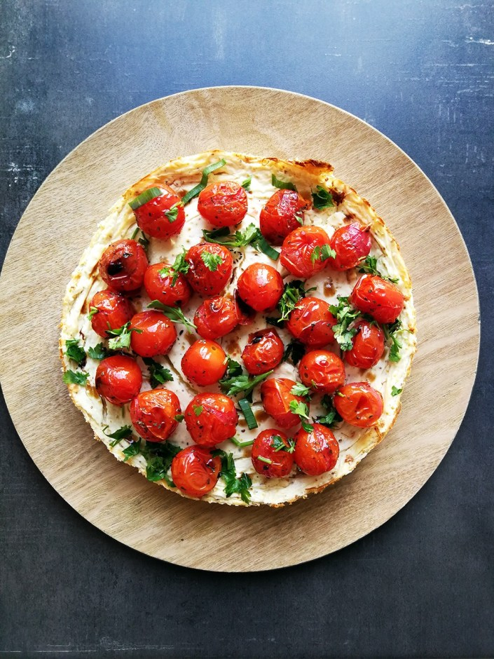 Baked Savoury Cheesecake with Cherry Tomatoes and Balsamic Vinegar on a wood serving tray - Homeology