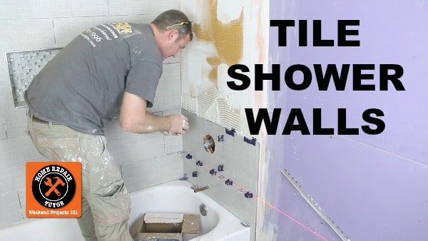 a shower wall and cut holes in tile