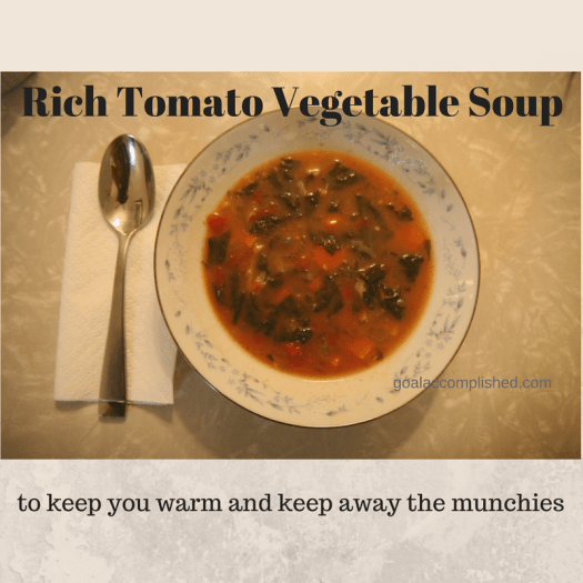 picture of Rich Tomato Vegetable Soup in fancy bowl, with spoon on the side