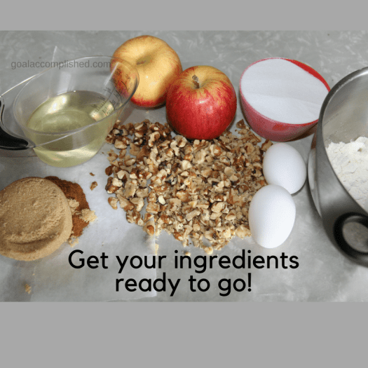 Get your ingredients ready to go. Picture of brown sugar, cinnamon, cooking oil, apples, chopped walnuts, 2 eggs, sugar, flour