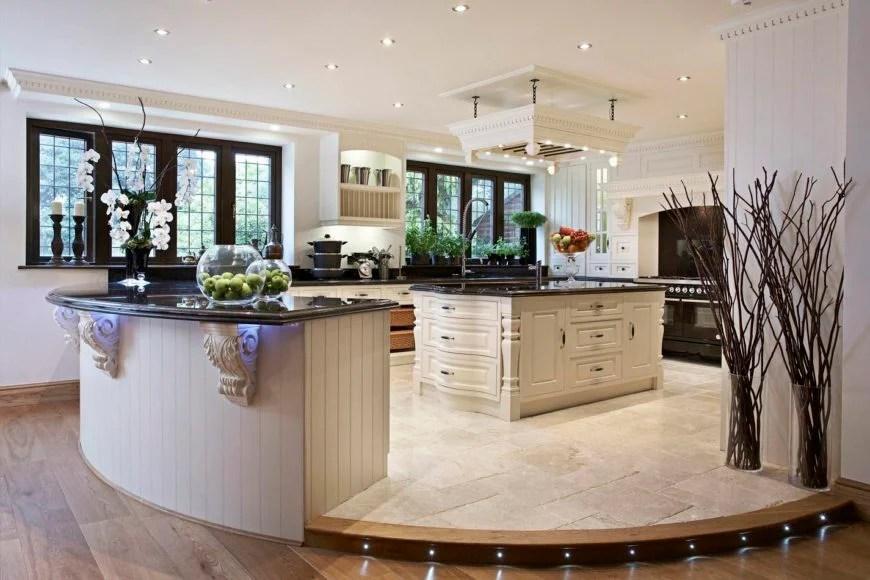 White, round kitchen with 2 islands.