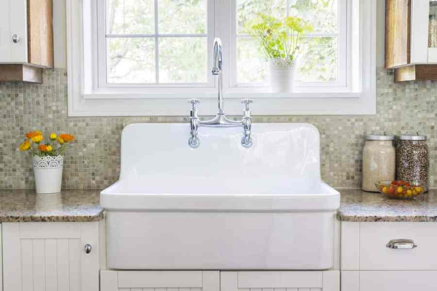 The 7 Different Types of Kitchen Sinks   Home Stratosphere White farmer style kitchen sink
