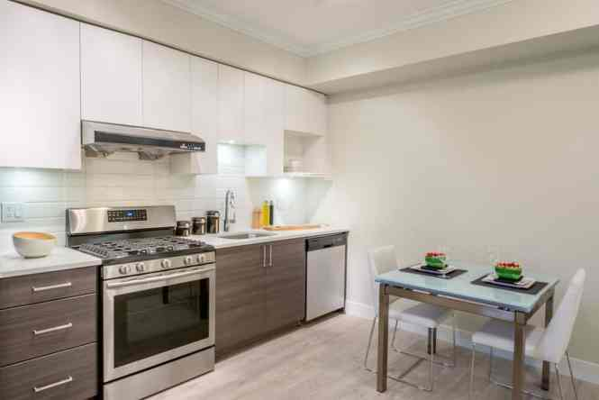 Apartment Kitchen With Small Table Set