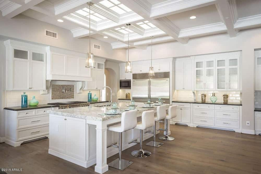 Another Look Of The Kitchen Showcasing Beautiful Ceiling Lighting And Cabinets